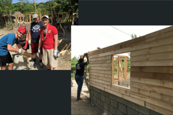 Group of Missionaries helping build a house
