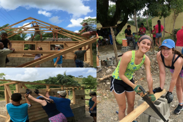 Missionaries building the roof frame